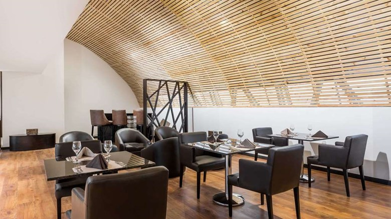 "Wyndham Quito Airport Restaurant. Images powered by <a href='http://web.iceportal.com'  target=""_blank"">Ice Portal</a>."