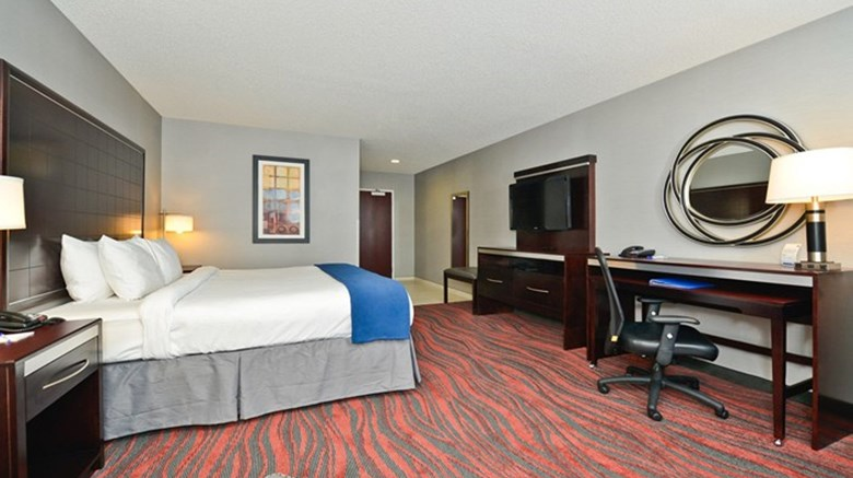 "Holiday Inn Express and Suites Utica Room. Images powered by <a href='http://www.leonardo.com'  target=""_blank"">Leonardo</a>."
