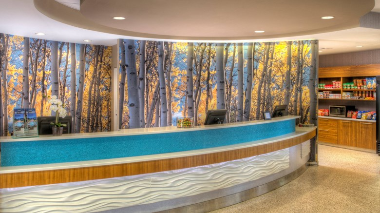 "SpringHill Suites University Lake Lobby. Images powered by <a href='http://www.leonardo.com'  target=""_blank"">Leonardo</a>."