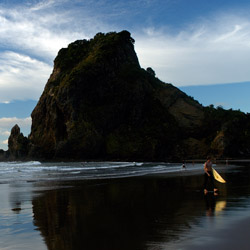 New Zealand's Piha beach is known for its black sand and good surf. // © 2014 Auckland Tourism