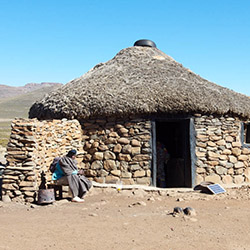 "<p>A village hut in Lesotho. // © 2014 Devin Galaudet</p><p>Feature image (above): Before entering Lesotho, travelers will pass through a ""no man's..."