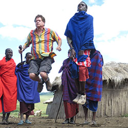 <p>Ken Firestone, cofounder and managing director of Zohar African Safaris' North American and global markets, with African natives // © 2015 Zohar...