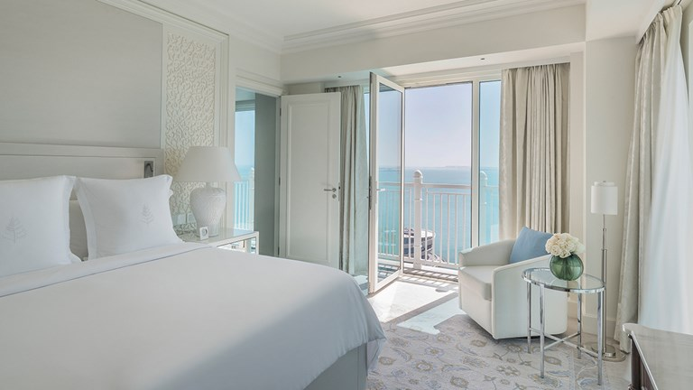 A sea-view guestroom faces the Arabian Gulf.