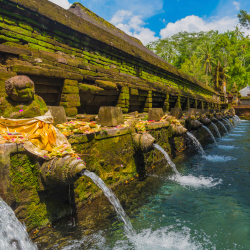 <p>Guests can bathe in holy springs at Tirta Empul. // © 2016 iStock</p><p>Feature image (above): The Tirta Empul water temple is dedicated to...