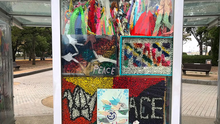 The Children's Peace Monument features glass cases filled with origami paper cranes.