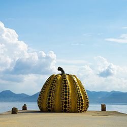 "<p>""Pumpkin"" by Japanese artist Yayoi Kusama, an outdoor exhibit at Benesse House Museum in Naoshima. // © 2015 Creative Commons user <a..."