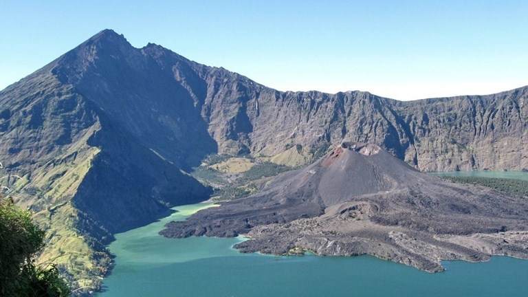 A strenuous hike to the top of Mount Rinjani yields marvelous views of its crater lake and surrounding natural landscape.