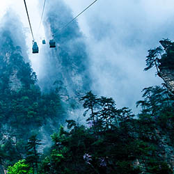 Travel along the world's longest cable car up to Tianmen Mountain. // © 2017 Okichina Travel Service