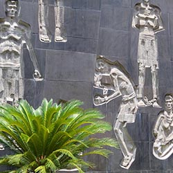 <p>A courtyard wall at Hoa Lo Prison Museum // © 2016</p><p>Feature image (above): Life-size figures help recreate the deplorable conditions for...