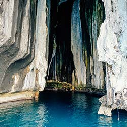 <p>A popular site where locals gather bird nests, Cathedral Cave is a great stop when touring El Nido for the first time. // © 2017 Michelle Rae...