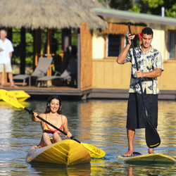"<p>Guests at Koro Sun Resort can head off on kayaking adventures from private docks attached to their overwater ""bures."" // © 2015 Koro Sun..."