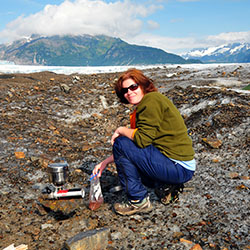 <p>Heather Batin enjoying a camping trip on a wilderness glacier. // © 2017 Christopher Batin</p><p>Feature image (above): Flying above western...