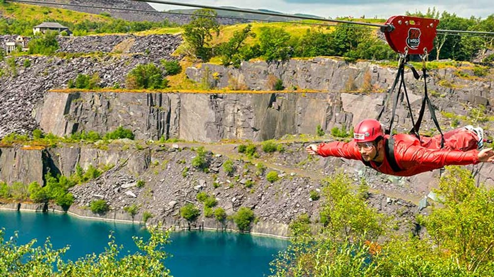Riders can zipline over cliffs and across canyons at speeds of up to (and sometimes over) 100 mph. // © 2016 Visit Wales 2