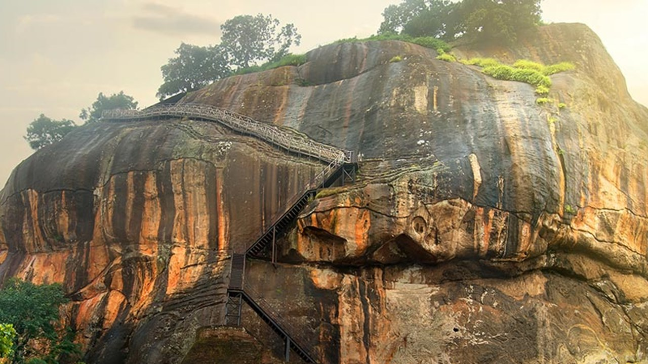 Located in Sri Lanka's Central Province, Sigiriya features a rock plateau that is more than 600 feet higher than the surrounding jungle. // © 2016 iStock 3