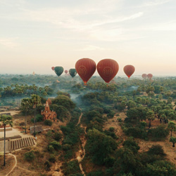 Hot-air balloons rise over the plains of Bagan, Myanmar. // © 2015 Melody Chen