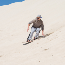 <p>In Qatar, clients can board on sand instead of waves or snow. // © 2015 Thinkstock</p><p>Feature image (above): Go dune bashing in a...