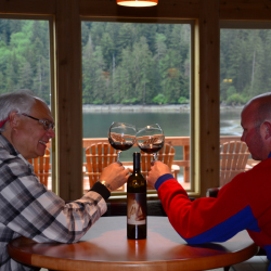 <p>A pair of anglers enjoying daily cocktails at Steamboat Bay. // © 2016</p><p>Feature image (above): Angler Ken Chin with a silver salmon he caught...