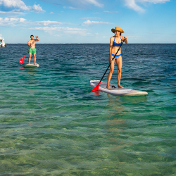 <p>Stand-up paddleboarding in Exmouth, Western Australia // © 2016 Coral Coast</p><p>Feature image (above): The outback meets the ocean at Yardie...