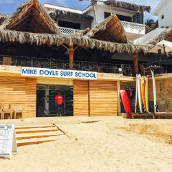 <p>Mike Doyle Surf School, located in front of the Acapulquito break, is one of the best surf schools in the area. // © 2016 Michelle Rae...