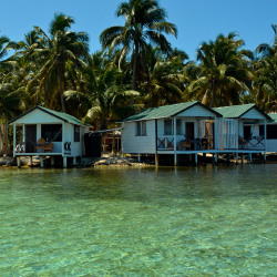 <p>Tobacco Caye Paradise features six private overwater cabanas. // © 2017 Debbie Olsen</p><p>Feature image (above): Guests can see the reef during a...
