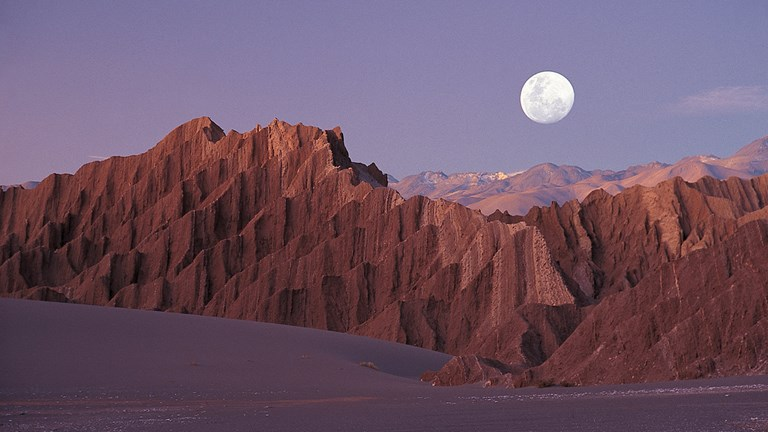 Chile's Atacama Desert features rocky mountains, conical volcanoes, sand dunes, sal flats, lagoons and more.