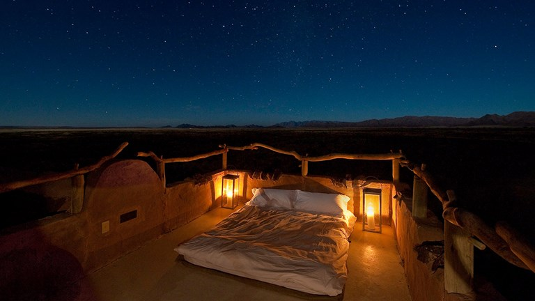 "Get a good (and beautiful) night's rest by sleeping on a rooftop ""star bed"" in the Namib."