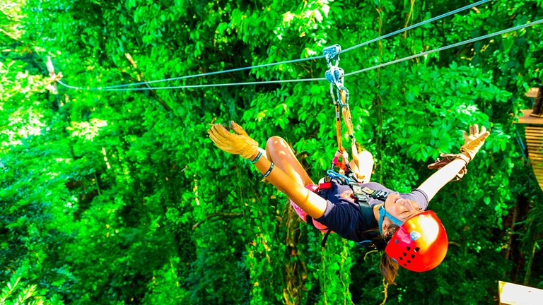 Zipline riders can soar at speeds of up to 40 mph.