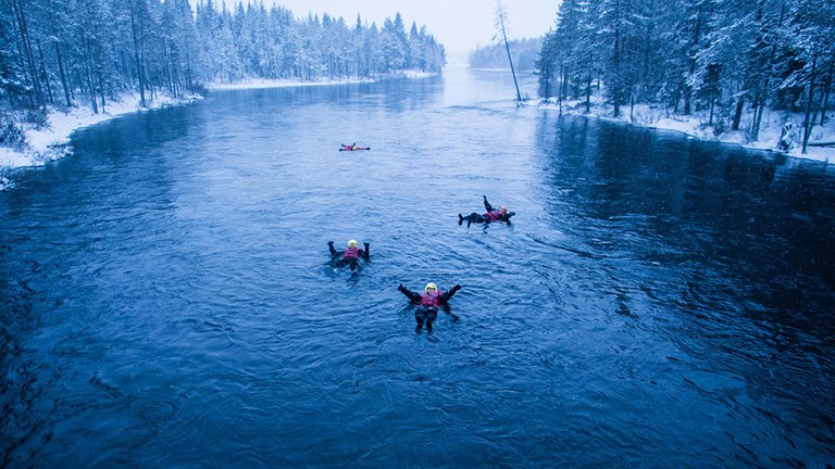 Travelers can float down the icy Kitkajoki River.