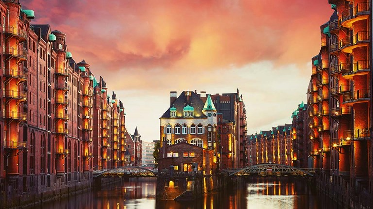 Take a boat tour through Hamburg's historic Speicherstadt warehouse district.