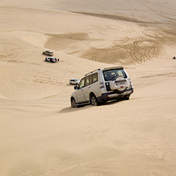 <p>Travelers can get their adrenaline fix by dune bashing in Qatar. // © 2017 iStock</p><p>Feature image (above): The Middle Eastern country blends...