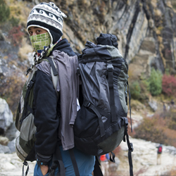<p>A Nepali Sherpa wears gear recommended on packing lists for Nepal treks. // © 2016 Mindy Poder</p><p>Feature image (above): When packing for a...