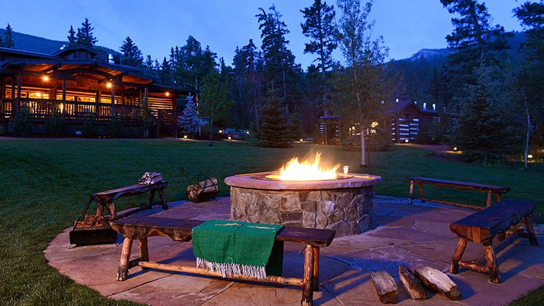 Guests can take advantage of facilities such as a cozy fire pit.