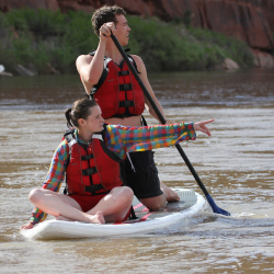 Families will love a stand-up paddleboard excursion along the Colorado River. // © 2016 Holiday River Expeditions