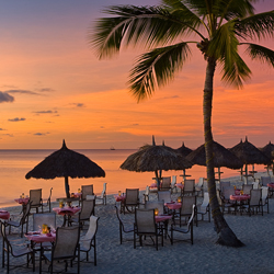 <p>Aruba Marriott's beachfront restaurant, Simply Fish, is a great place for a sunset dinner. // © 2014 Aruba Marriott Resort & Stellaris...