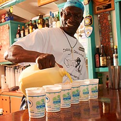 "<p>Soggy Dollar Bar's signature ""Painkiller "" cocktail is made with dark rum, cream of coconut, pineapple and orange juice and topped with fresh..."