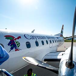 <p>Cayman Airways is responsible for the transport of 43 percent of visitors to the islands. // © 2016 Cayman Islands Department of...