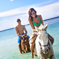 <p>Chukka's Horseback Ride 'n' Swim in Sandy Bay tour lets client take a dip in the ocean with their horse. // © 2015 Chukka Caribbean...