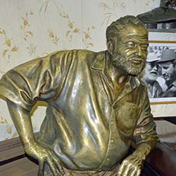 <p>A bronze statue of Ernest Hemingway sits at Floridita bar and restaurant in Old Havana. // © 2016 Greg Olsen</p><p>Feature image (above): Stepping...