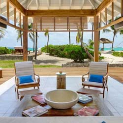 <p>Accommodations at Petit St. Vincent include a collection of beach bungalows with modern furnishings. <br />// © 2014 Petit St....