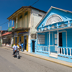 <p>A colorful Victorian-style house in Puerto Plata // © 2015 Dominican Republic Ministry of Tourism</p><p>Feature image (above): Bask in the sunshine...