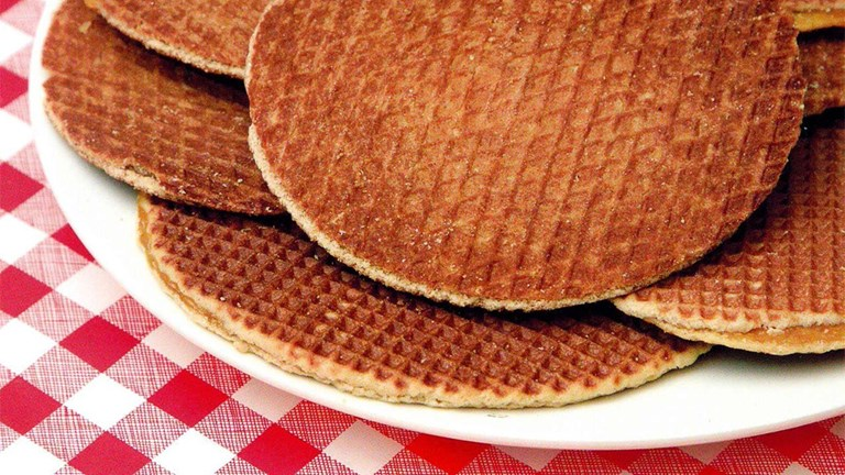 Stroopwafels are typically enjoyed warm and accompanied by a hot cup of coffee.