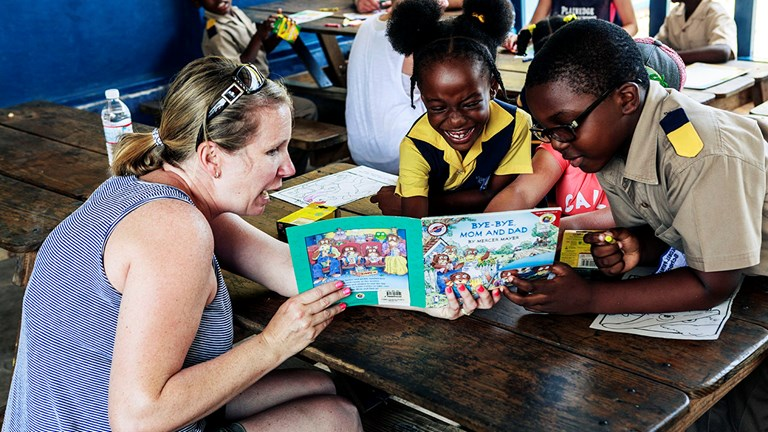 The Sandals Foundation's Reading Road Trip program is a weekly voluntourism excursion that connects visitors to locally supported schools and its students.