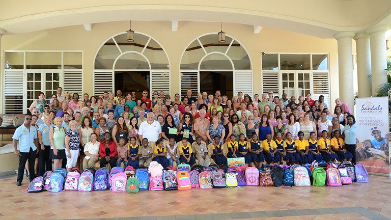 Travel advisors show their support for the Sandals Foundation by bringing much-needed school supplies to local students in Jamaica.