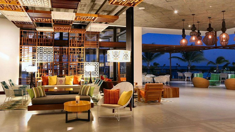 Travelers can relax and recharge in the TRS Cap Cana Hotel lobby.