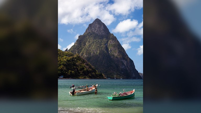 The Pitons are two volcanic spires located on St. Lucia.