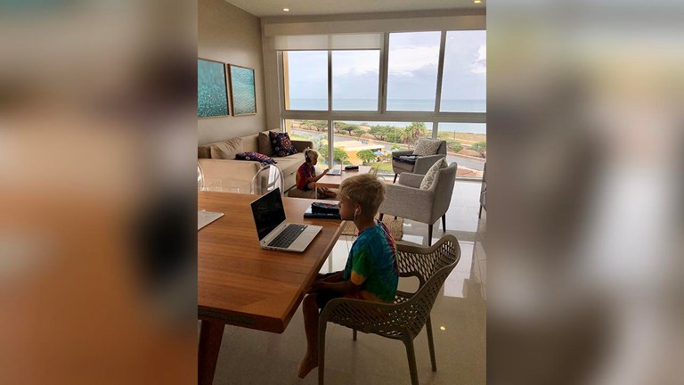The twins attend school virtually from their hotel room.
