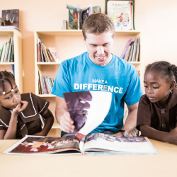 Adam Stewart, president of the Sandals Foundation and CEO of Sandals Resorts International, reads to local children. // © 2014 Sandals Resorts...