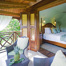 Guestrooms at C'est la Vie are designed in traditional Caribbean style. // © 2014 C'est la Vie