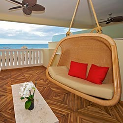 <p>All suites at Iberostar Grand Hotel Rose Hall feature private furnished balconies. // © 2016 Iberostar Grand Hotel Rose Hall</p><p>Feature image...