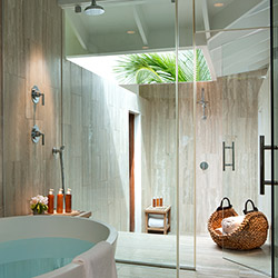 <p>A three-bedroom villa's bathroom at The Cove // © 2017 David Cowan</p><p>Feature image (above): The resort covers 40 acres of the Bahamas'...